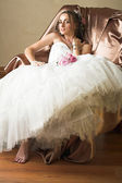 Bride with brown long hair sitting in chair — Stock Photo