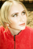 Young blond woman in red jacket — Stock Photo
