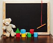 Blackboard with bear and blocks — Stock Photo