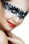 Woman in silver mask. — Stock Photo