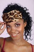 Beautiful African woman in sleeping mask — Stock Photo