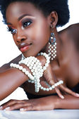 South African woman with pearls. — Stock Photo
