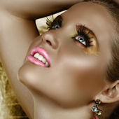 Fantasy golden make-up. — Stock Photo