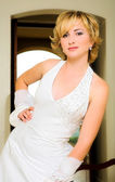 Beautiful blond bride in halter neck dress — Stock Photo