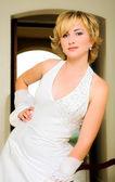 Beautiful blond bride in halter neck dress — Stock Photo