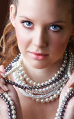 Blond woman in pearls. — Stock Photo