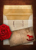 Rose, envelope and card — Stock Photo