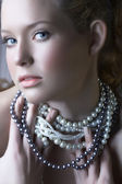 Blond beauty in pearls — Stock Photo