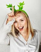 Reindeer hat on fun woman. — Stock Photo