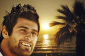 Man on the sunset beach — Stock Photo