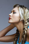 Blond woman with braids. — Stock Photo