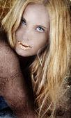 Gold blond woman on grunge. — Stock Photo