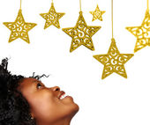African woman and Christmas stars — Stock Photo