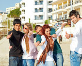 Turkish students showing thumbs up on the beach . — Stock Photo