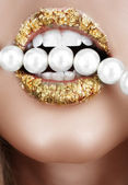 Gold leaf mouth with pearls. — Stock Photo