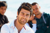 Turkish young man with friends. — Stock Photo