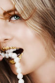 Beautiful woman with gold leaf on her lips — Stock Photo
