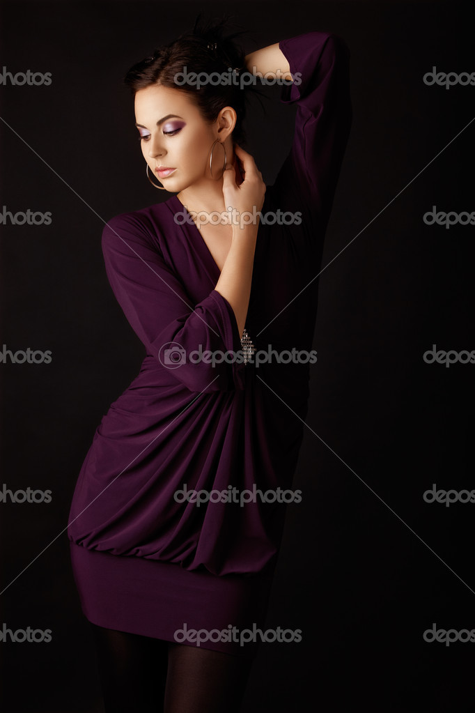 Beautiful fashion model in a purple mini dress and tights, wearing purple eyeshadows . — Stock Photo #5396158