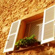 French window qith white shutters - Stockfoto