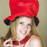 blond w czerwony kapelusz — Zdjęcie stockowe