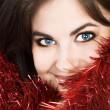 Stock Photo: Beautiful brunette womwith tinsel