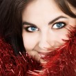 Beautiful brunette womwith tinsel — Stock Photo #5411232