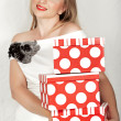 Woman in white dress and red boxes. — Stock Photo