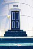 Lighthouse entrance with old steps — Stock Photo