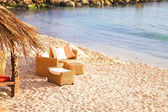 Chairs on the beach next to sea in Antibes — Stock Photo