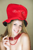 Blond in red hat — Stock Photo