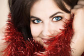 Beautiful brunette woman with tinsel — Stock Photo