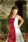 Grunge Beautiful smiling bride in red and white dress — Stock Photo