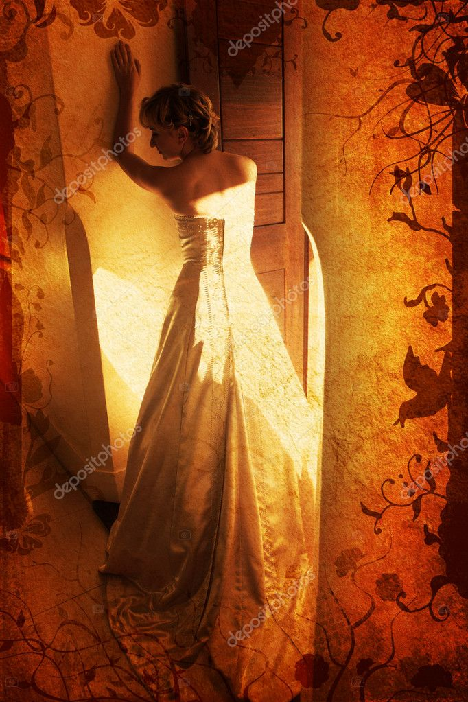 Blond bride in sleeveless wedding dress against wall standing with her back on grunge swirls and scrolls background — Stock Photo #5411374