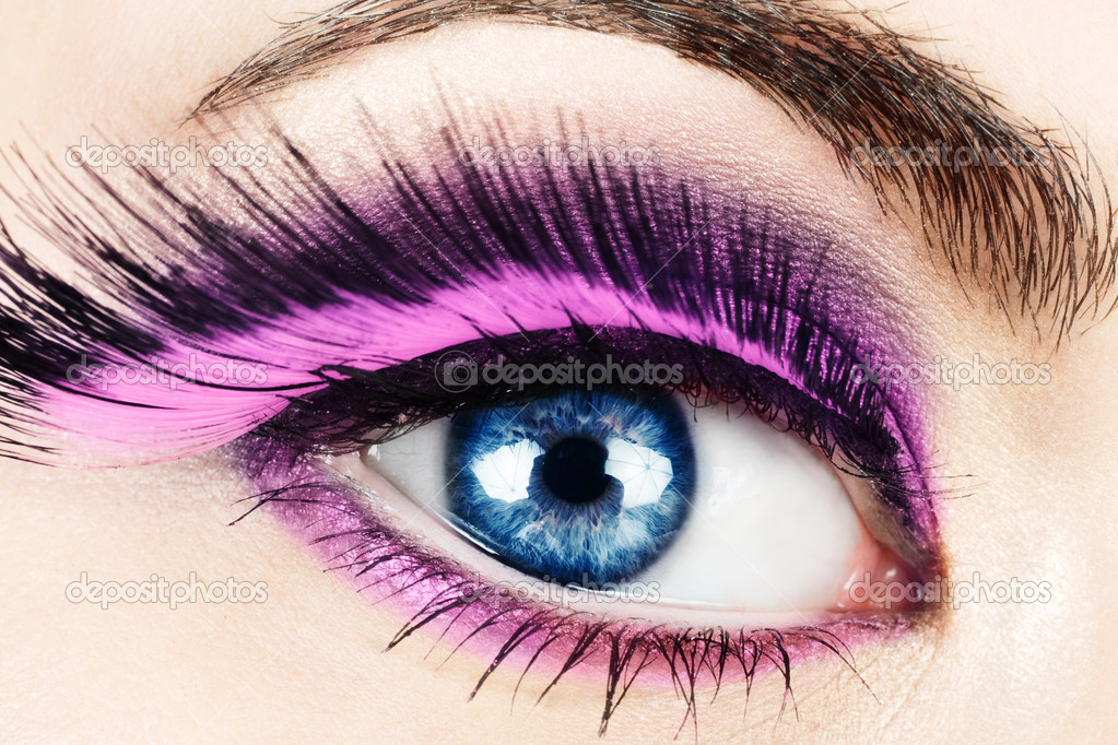 Macro of woman's eye with long pink feather fake eyelashes. — Stock Photo #5681061