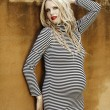 Beautiful eight months pregnant blond woman — Stock Photo