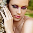 Beautiful woman with dramatic makeup and grey manicure. — Stock Photo