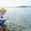 Little boy in the sea — Stock Photo