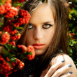 Beautiful woman with coral lips — Stockfoto