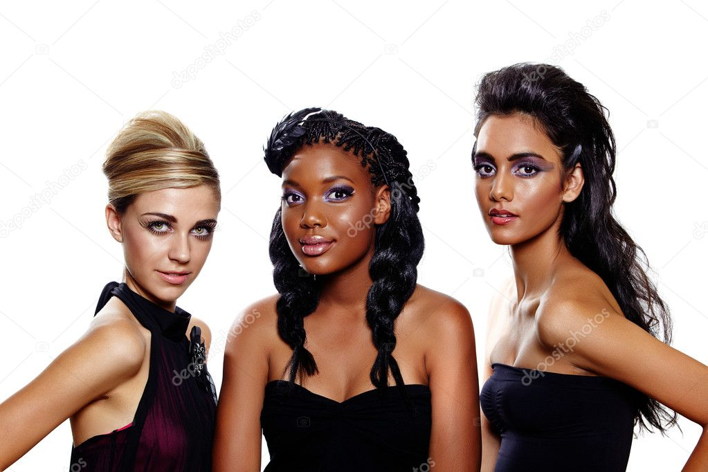 Three beautiful women of different races with different makeup and fashion hairstyles over white background. Focus on the blond  Stock Photo #6123912