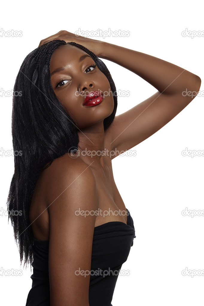 Portrait of beautiful South African young woman with long hair loose hair and bright red lips wearing black corset over white background. — Stock Photo #6124373