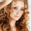 Beautiful blond girl with curly hair — Stock Photo