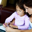 Mother and daughter doing homework — Stok fotoğraf