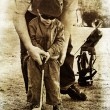 Father and son play golf - Stock Photo