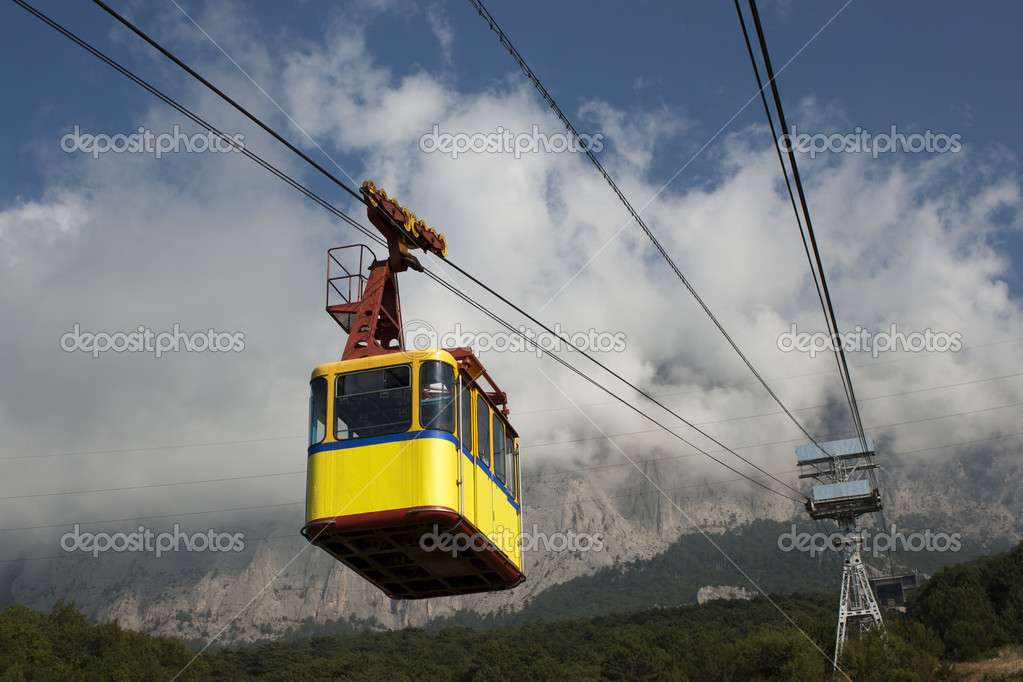 The cable car in Crimea Ai-Petri on a background of mountains covered with clouds — Stock Photo #6495882