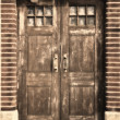 An old wooden door in sepia — Stock Photo