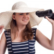 A girl in a sailor cap looks through binoculars — Stock Photo