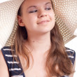 Stock Photo: A girl in a big straw hat