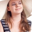 A girl in a big straw hat — Stock Photo