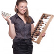 Girl with big wooden accounts and money — Stock Photo #5751372