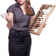 Girl with big wooden accounts and money — Stock Photo #5751378